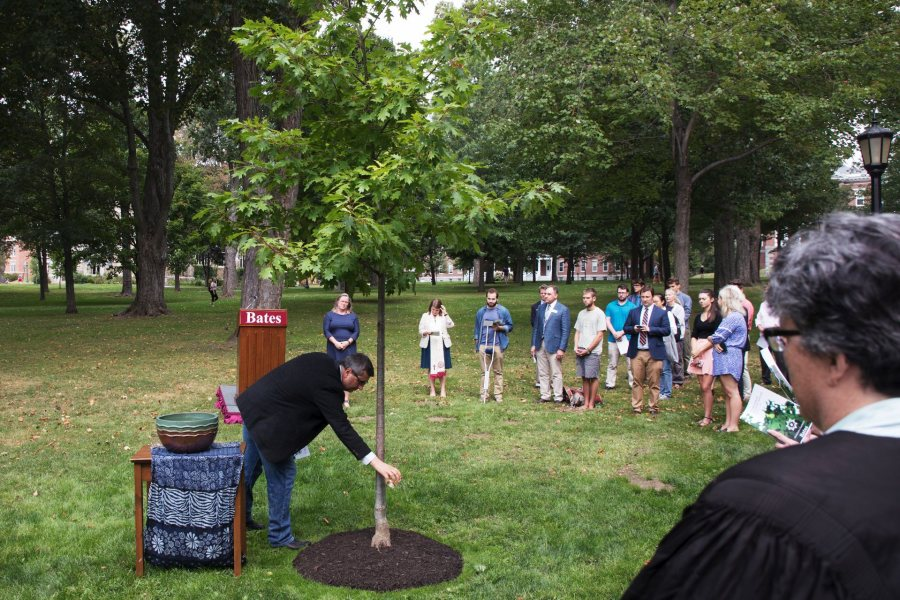 Members of the Bates community participate in a Memorial Tree Planting on the Quad across from Lindholm House immediately following the Convocation on Tuesday. A tree was planted in memory of all those in the Bates community who died during the past year.