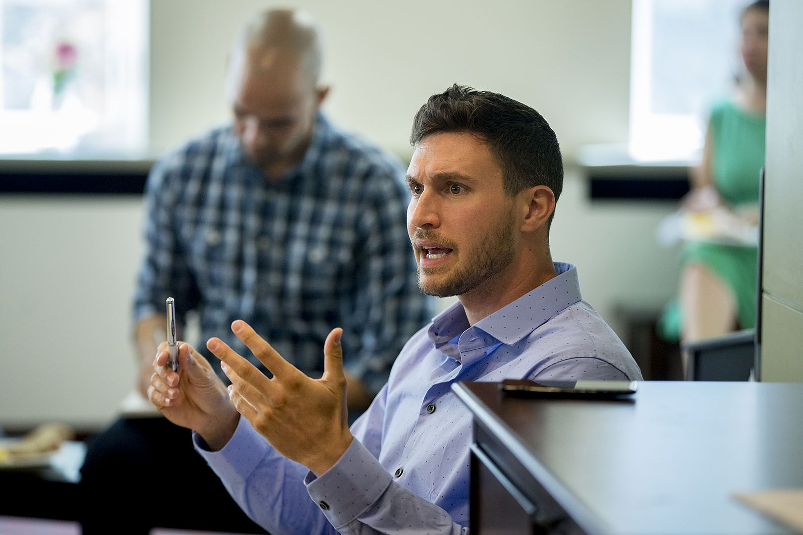 Christopher Petrella '06 makes a point during a meeting of the college's Justice and Equity Reading Group on Sept. 13, 2017. Petrella, faculty lecturer and associate director of programs for the Office of Equity and Diversity, is the group organizer. (Phyllis Graber Jensen/Bates College)
