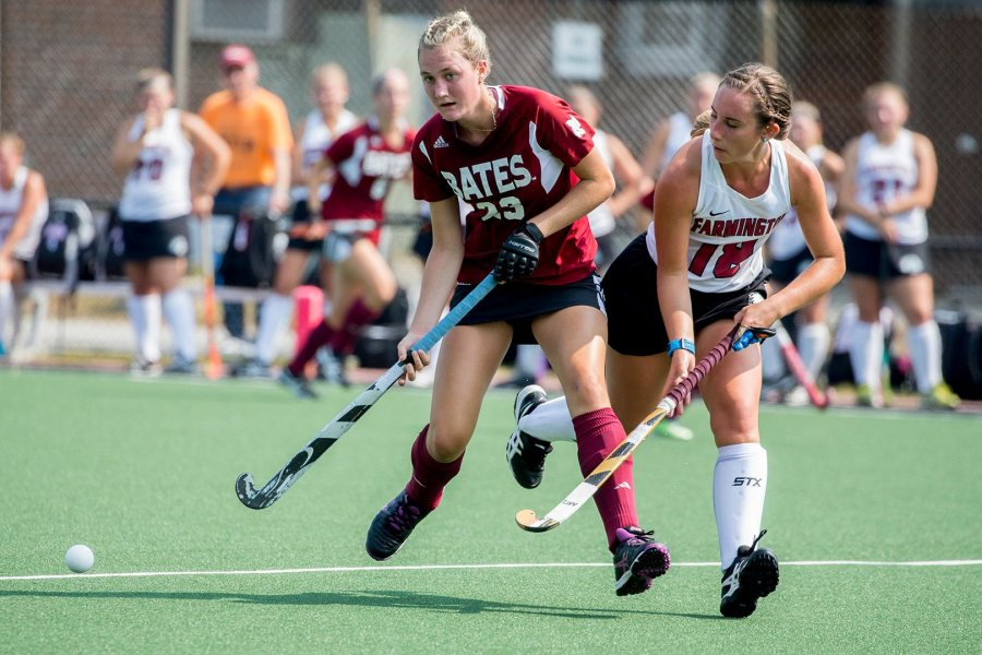 Field hockey takes on Middlebury on OCt. 21. Shown: Grace Fitzgerald '20 with an opponent from Maine–Farmington. (Phyllis Graber Jensen/Bates College)