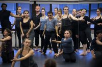 A moment for reflection: The dance repertory performance class appears in a mirrored wall in the Plavin studio. (Theophil Syslo/Bates College)
