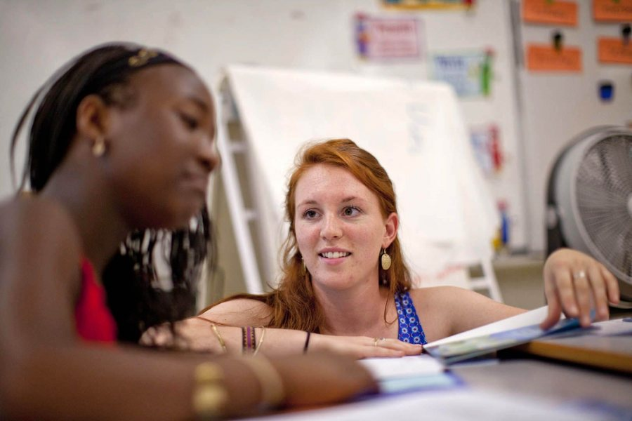 Brenna Callahan '15 works with a students at Montello School in July 2014. (Phyllis Graber Jensen/Bates College)