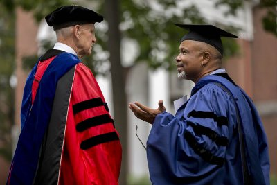 Tuesday, Sept. 5: Professor Emeritus of Sociology Sawyer Sylvester talks with Professor of Religious Studies Marcus Bruce '77 after Convocation. (Phyllis Graber Jensen/Bates College)