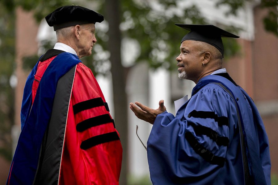 Professor Emeritus of Sociology Sawyer Sylvester talks with Professor of Religious Studies Marcus Bruce '77 after Convocation. (Phyllis Graber Jensen/Bates College)