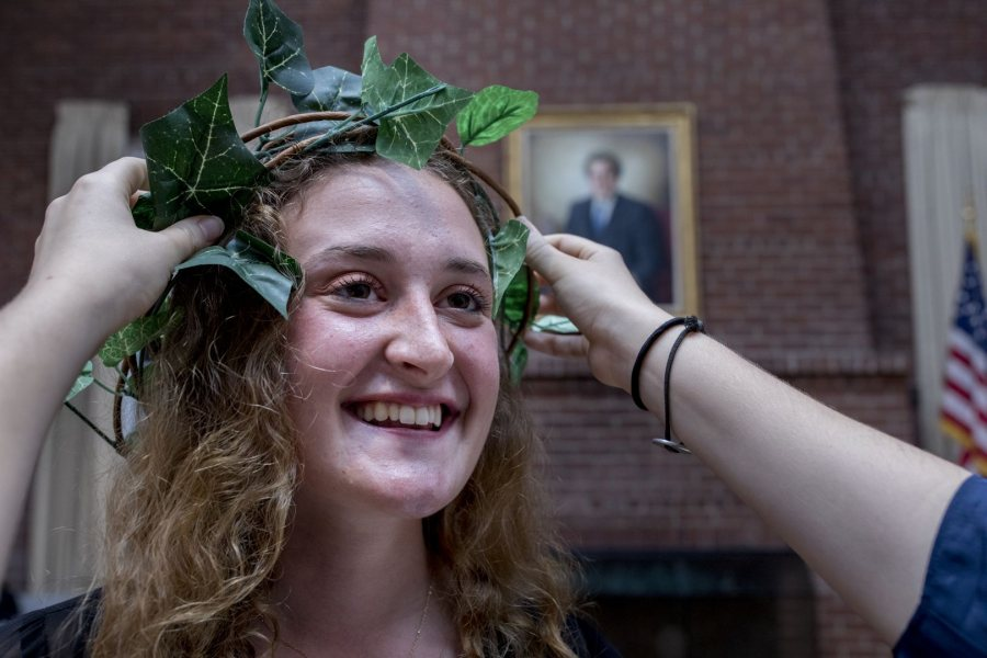 Caroline Barnes '19 of Sarasota Springs, N.Y. is inducted into Eta Sigma Phi, the national classics honor society, on Sept. 27 in the Muskie Archives. (Phyllis Graber Jensen/Bates College)