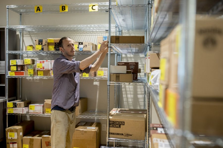 Bobby Bosse, supervisor of mail and package services at Post & Print, sorts package deliveries on Oct. 10. Post & Print will receive upwards of 70,000 by the end of 2017. (Phyllis Graber Jensen/Bates College)