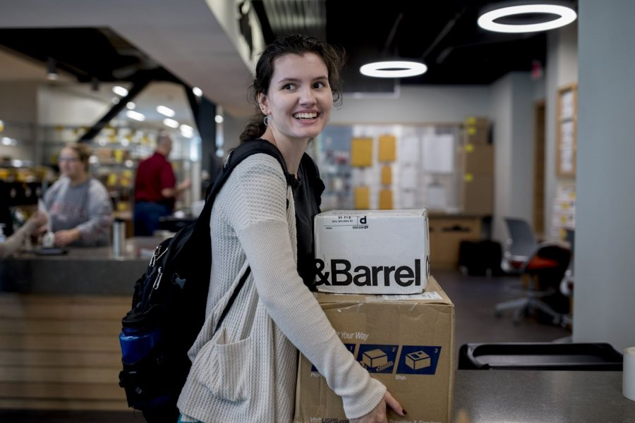 Katie Stone '19 of Riverwood, R.I. carries away birthday gifts sent by friends and relatives on Oct. 10. (Phyllis Graber Jensen/Bates College).