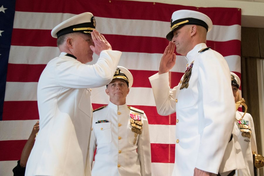 J.J. Cummings '89 (right) assumes command of USS <em>Gerald R. Ford</em> from Capt. Richard C. McCormack during the ship's change of command ceremony, a time-honored Naval transfer of responsibility, authority, and accountability from one individual to another. (U.S. Navy photo by Mass Communication Specialist 2nd Class Cat Campbell)