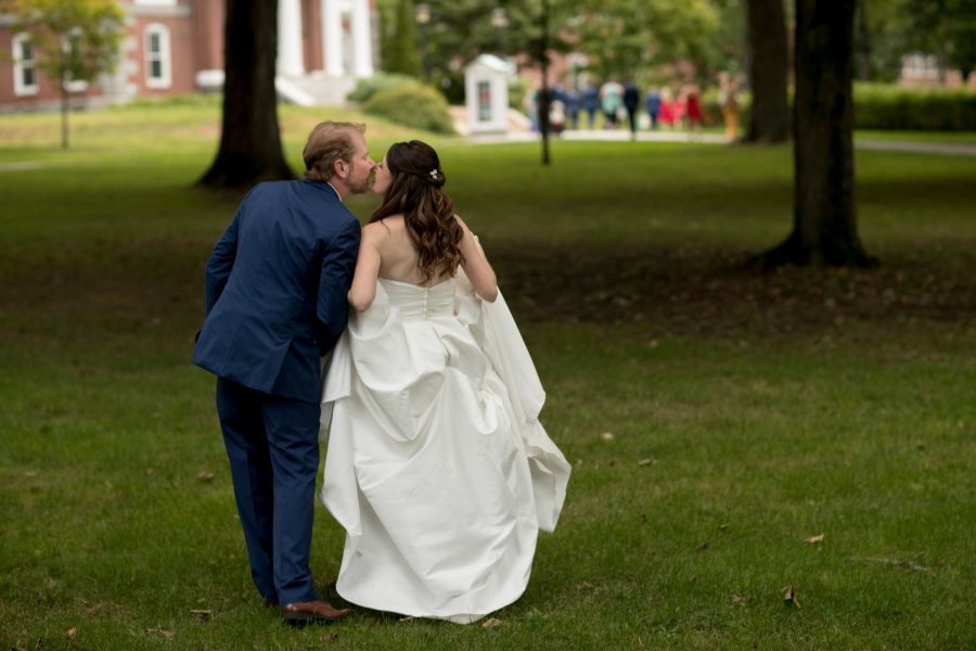 """Bates alumni Elizabeth Merrill '00 and Lawson Rudasill '00 were married in the Bates College Chapel, with a """"first look"""" and Ketubah (marriage contract) signing at Lake Andrews, followed by a cocktail hour in Commons' Fireplace Lounge, and a reception in Pettengill Hall's Perry Atrium. The ceremony officiants were Cynthia Link '00 and Ed Pauker '00."""