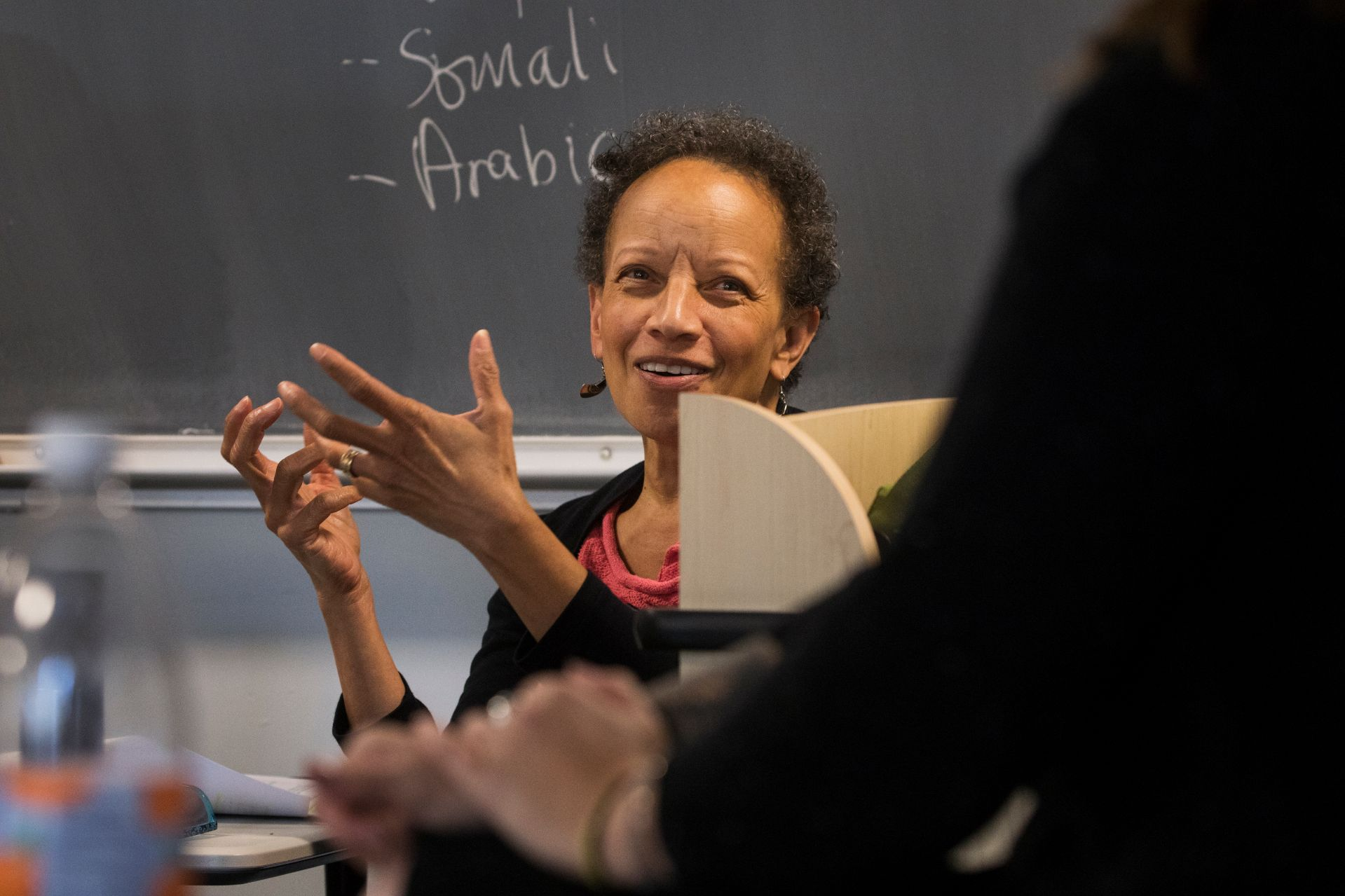 During a session of her course on gender and sexuality in U.S. politics, Associate Professor of Politics Leslie Hill responds to guest presenter Whitney Parrish of the Maine Women's Lobby and Maine Women's Policy Center. (Theophil Syslo/Bates College)
