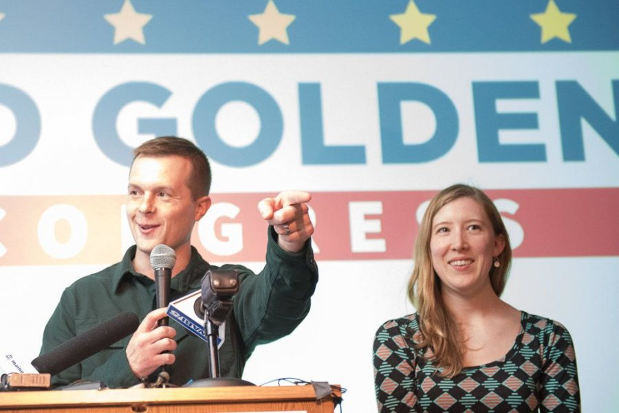 Jared Golden '11 greets his supporters at the Franco Center in Lewiston late Tuesday night. On his right is his wife Isobel Golden '11. (Russ Dillingham/Sun Journal)