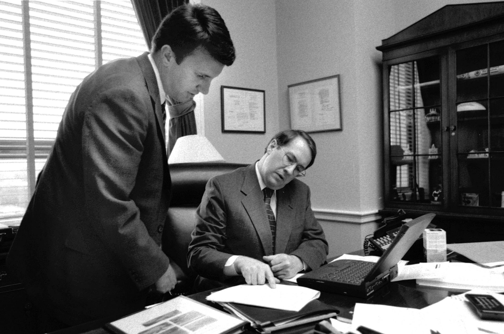 In July 1999, Ben Cline '94 (left) confers with Rep. Bob Goodlatte '74, R-Va., in Goodlatte's office in the Rayburn House Office Building. A the time, Cline was Goodlatte's legislative director. (Phyllis Graber Jensen/Bates College)