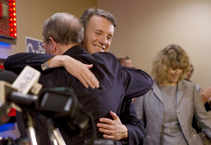 Ben Cline '94, R-Va., elected to the U.S. House on Tuesday night, hugs outgoing Rep. Bob Goodlatte '74 before giving his acceptance speech in Roanoke. (Heather Rousseau / copyright <em>The Roanoke Times</em>, reproduced by permission)