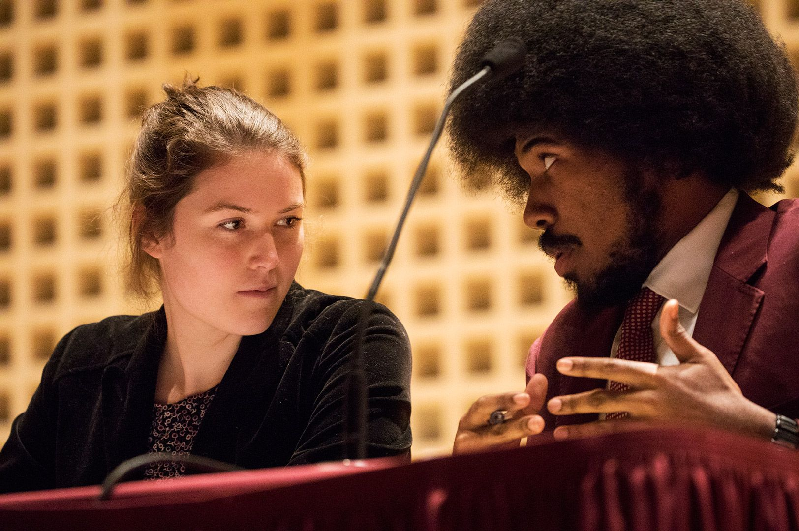 Abby Westberry '19 and senior William Coggins of the Morehouse College debate team deliberate before the Rev. Dr. Benjamin Elijah Mays, Class of 1920, Debate on Jan. 15, 2018. (Theophil Syslo/Bates College)