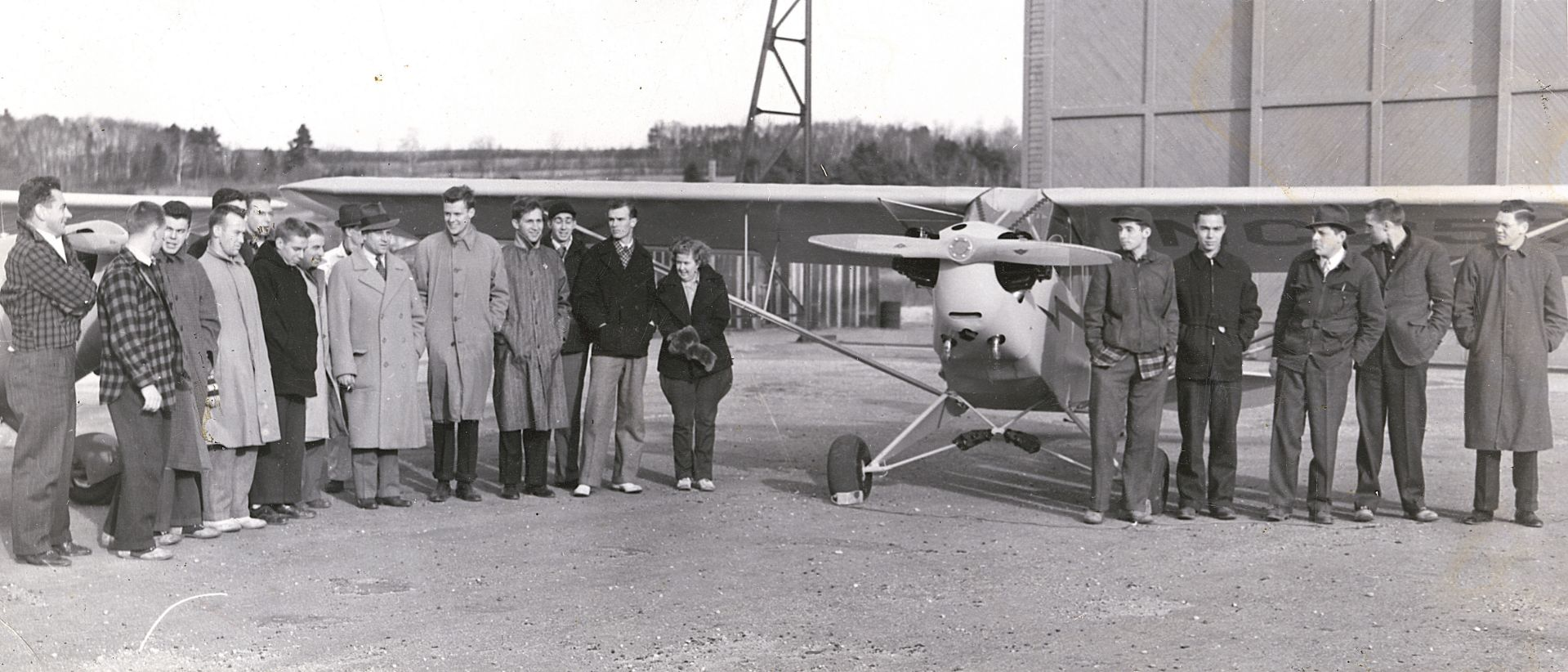 Bates students post fliers flew the famous Piper J-C Cub and a pre-war Aeronca model.