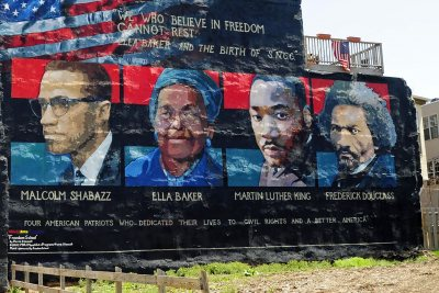 "Mural on the wall of row houses in Philadelphia. The artist is Parris Stancell, sponsored by the Freedom School Mural Arts Program.Left to right; Malcolm Shabazz (Malcolm X), Ella Baker, Martin Luther King, Frederick Douglass.The quote above the pictures,""We Who Believe in Freedom Cannot Rest"", is from Ella Baker, a founder of SNCC (Student Non-Violent Coordinating Committee), a civil rights group. which amongst other contributions, helped to coordinate ""Freedom Rides""in the early 1960's.Tony Fischer [CC BY 2.0 (https://creativecommons.org/licenses/by/2.0)], via Wikimedia Commons"