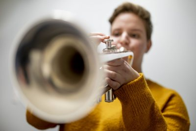 "Julia Jesurum '22 of Weston, Mass., practices the trumpet following a jazz band rehearsal in the Olin Arts Center Concert Hall. ""I love improving myself on the trumpet, trying to get my best tone,"" says Jesurum, who's been playing since the fourth grade (Phyllis Graber Jensen/Bates College)"