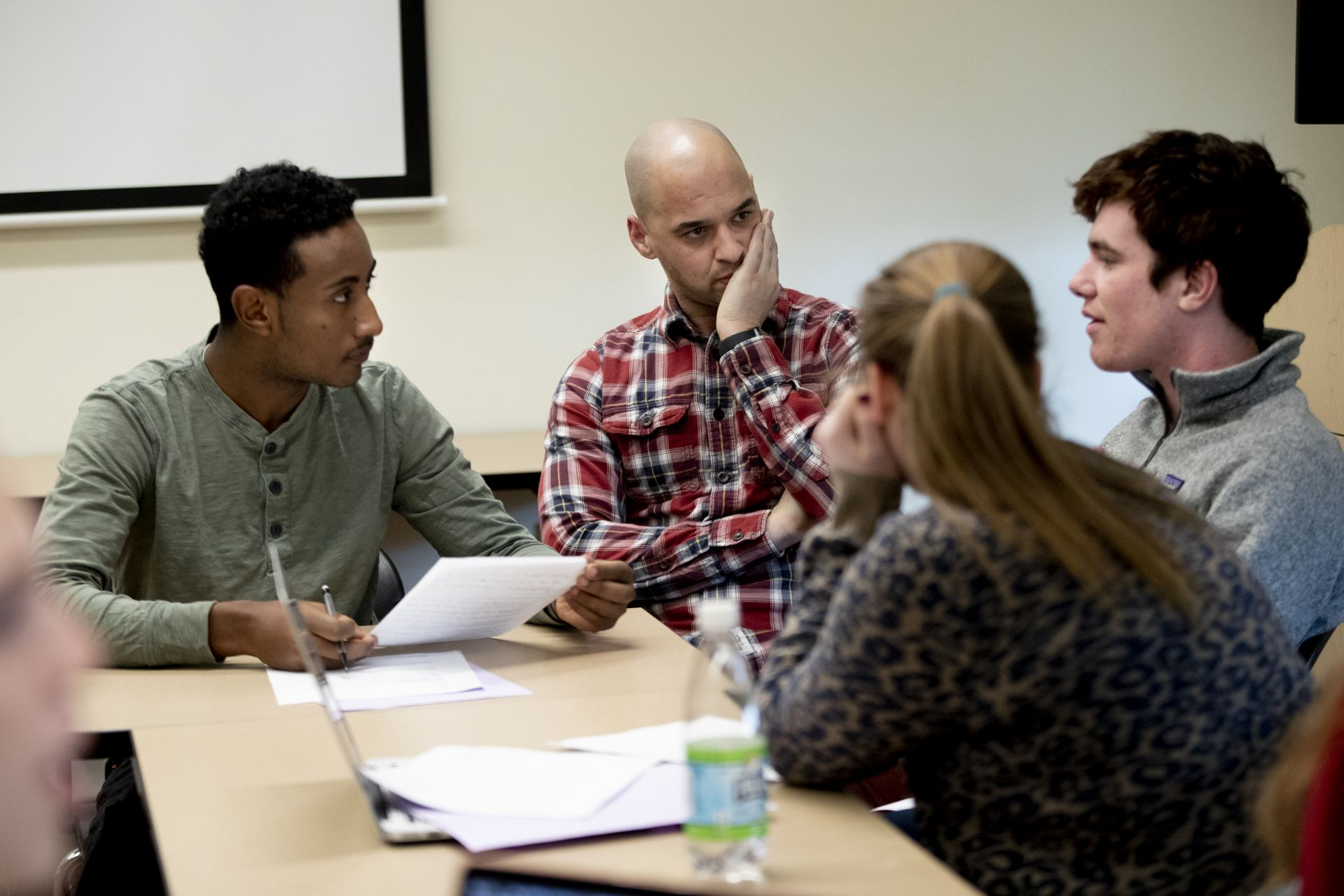 """A day in the life of Pettengill Hall, featuring staff, faculty and students engaged in learning, studying, and working, with both internal and external images.Andrew Baker teaches """"Black Resistance in U.S. History,"""" 116"""