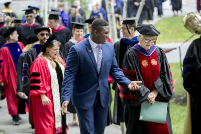 "Convocation, held at 11 a.m. today on the Historic Quad, ""provided Bates with an opportunity to welcome the Class of 2022, to celebrate the opening of the college, and to consider, as a community, our shared goals and hopes for the academic year,"" said President Clayton Spencer..Led by the College Mace Bearer Michael Murray, Phillips Processor of Economics, the Convocation procession included President Spencer, Student Body President Walter Washington '19 of Fleetwood, N.Y., and Associate Professor of History Joe Hall..According to Spencer, ""the College has resuscitated what was once a Convocation tradition at Bates: asking the outgoing senior class to select a faculty speaker for the incoming freshman class."" In this case, the Class of 2018 chose Hall to address the Class of 2022 -- and the entire Bates community. His talk was titled, ""Questions for Bates."".Immediately following Convocation, members of the Bates community attended a brief tree-planting ceremony, on the Quad behind Carnegie Science, held in memory of those in the Bates community who died during the past year. The ceremony was followed by a lunch will be served on the Library Quad for the college community."