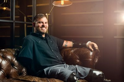 Travis Mills, a Maine resident and Army veteran who became a quadruple amputee in combat and is now an advocate for combat-injured veterans, will receive an honorary Doctor of Humane Letters degree. (Photograph by Sean Berry)