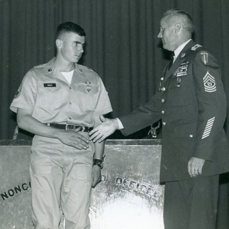 In May 1969, David Nash '68 is congratulated by First Sgt. Raymond Jenkins as a Distinguished Graduate of his noncommissioned officer training program at Fort Benning, Ga. (Photograph by Sgt. L. Herrmann)