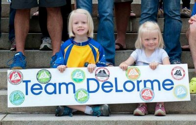 Abby and Emma Noble have been watching, volunteering at, or riding the Trek Across Maine for their whole lives. Here, they're literally the poster children for the riding team at DeLorme, the satellite communications company that was bought by Garmin in 2016. (Courtesy of Chip Noble).