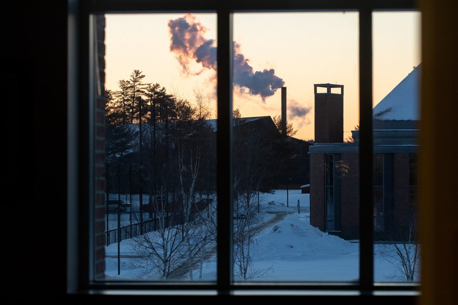 A day in the life of Pettengill Hall, featuring staff, faculty and students engaged in learning, studying, and working, with both internal and external images.Looking through the windows of the second floor AAACS lounge toward the Cutten smokestack.