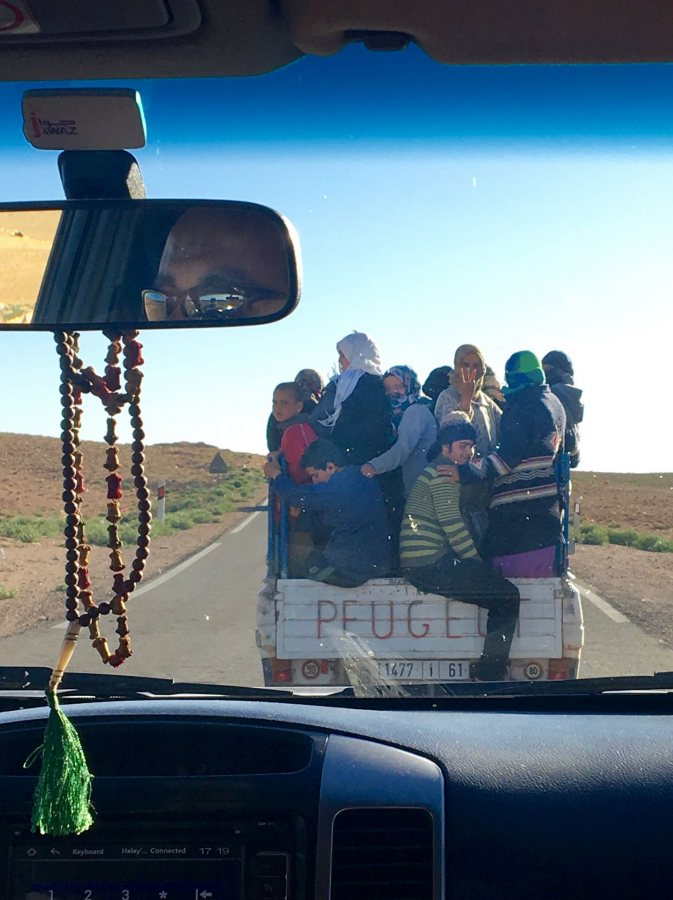 Crim, Haley IHP Climate Change (Multi-Country) Spring 2018 After spending a week studying environmental protest in Morocco, our van got stuck behind the only other car on the road: a truck full of activists from the Imider protest camp, the longest running environmental protest on earth. The woman in the middle is giving the sign of the movement, which our driver returned in solidarity. The activists had spent the day protecting a water main valve that they shut off so that a nearby silver mine couldn't deplete the water used by local people. This truck was heading home as another shift came to take their place, as they have been doing for the past 8 years. This photo was selected for the 2019 Barlow Off-Campus Photography Exhibition and shown at the 2019 Mount David Summit on March 29, 2019.