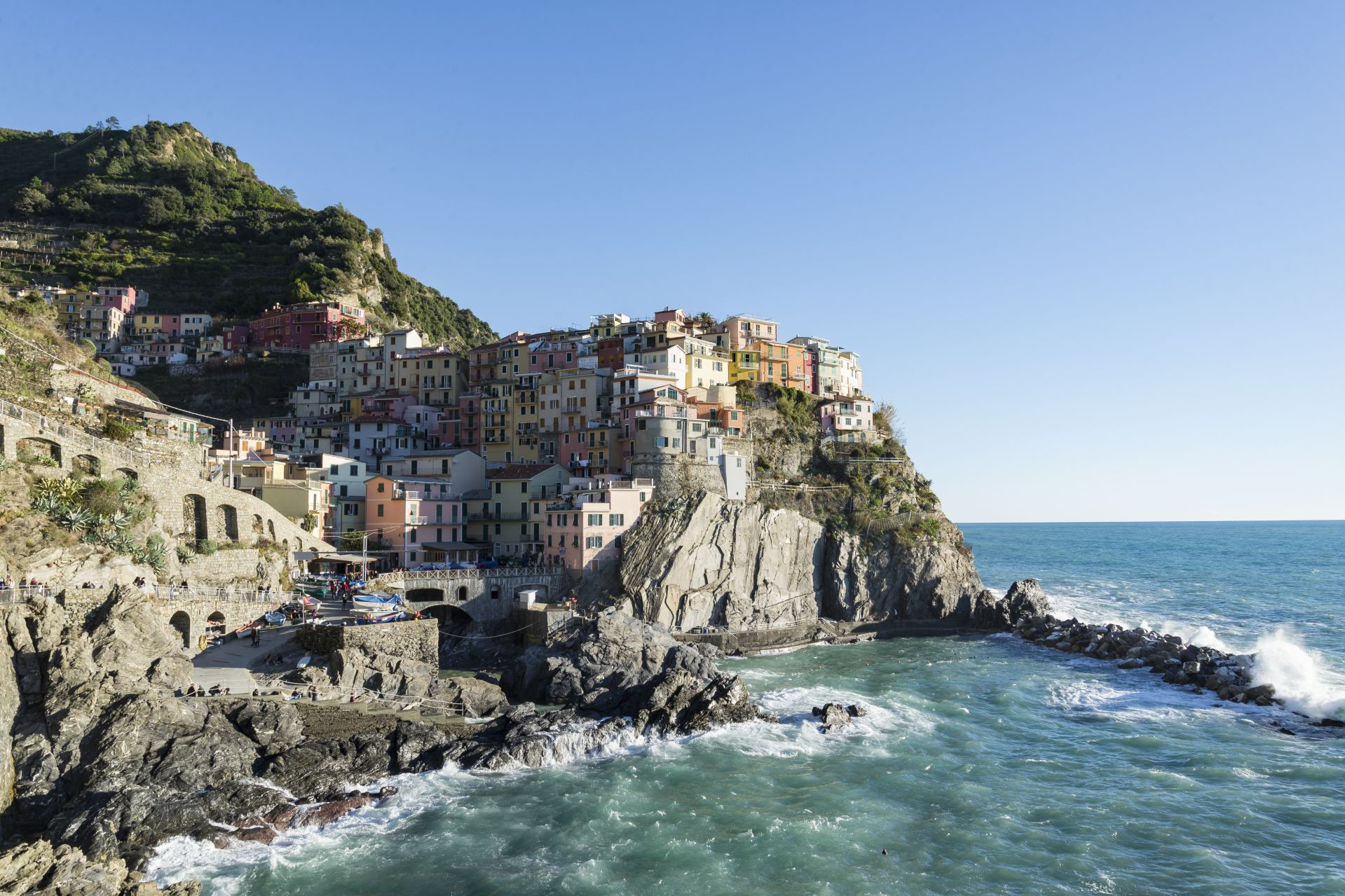 MacDonald, James Trinity Rome Fall 2018 View of village of Manarola in La Spezia, Italy from the cliff side trail along the coast. Over one weekend in early December, I visited the Cinque Terre Villages. The coastline views and the scenic hiking trails were breath-taking, but what caught my eye the most were the beautiful colors of the Ligurian town houses that decorated these villages. A little faded due to the midday sun, these houses still stood tall and vibrant, perched up on cliffside in their settled, organized blocks. With the town houses coupled with the rock-face and an active sea, I aimed to capture the beautiful scenes that attract nearly two and a half million visitors each year. Having now visited them myself, I have come to understand a little better why these rustic fishing villages are so beloved by so many. This photo was selected for the 2019 Barlow Off-Campus Photography Exhibition and shown at the 2019 Mount David Summit on March 29, 2019.