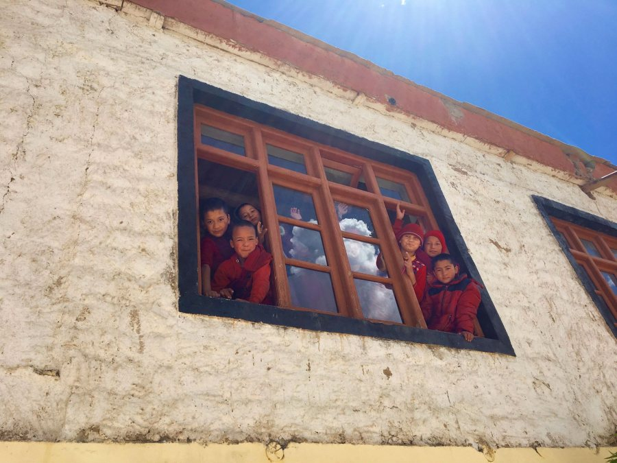 Sullivan, Lydia India ST 2018 Novice monks peering their heads out of the window of their classroom at the Skurbuchan Monastery in Ladakh, India. They waved goodbye as we left the monastery to hike down to our campsite in the village.This photo was selected for the 2019 Barlow Off-Campus Photography Exhibition and shown at the 2019 Mount David Summit on March 29, 2019.
