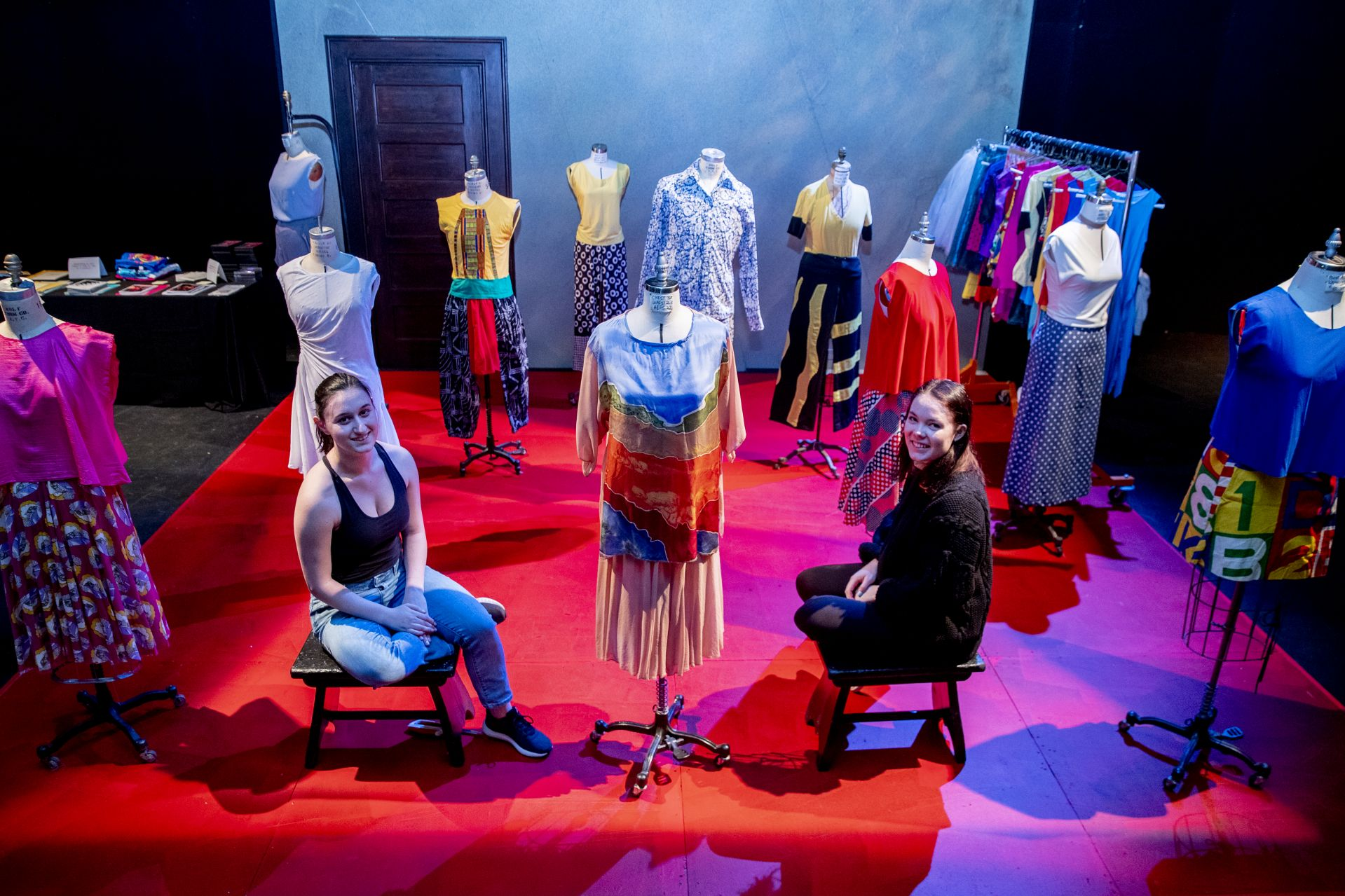 In Gannett Theater, Sara Hollenberg '19 of Stamford, Conn., and Rebecca Howard '19 of Aspen, Colo., pose among items that they curated for an interactive dance archives exhibition. (Phyllis Graber Jensen/Bates College)
