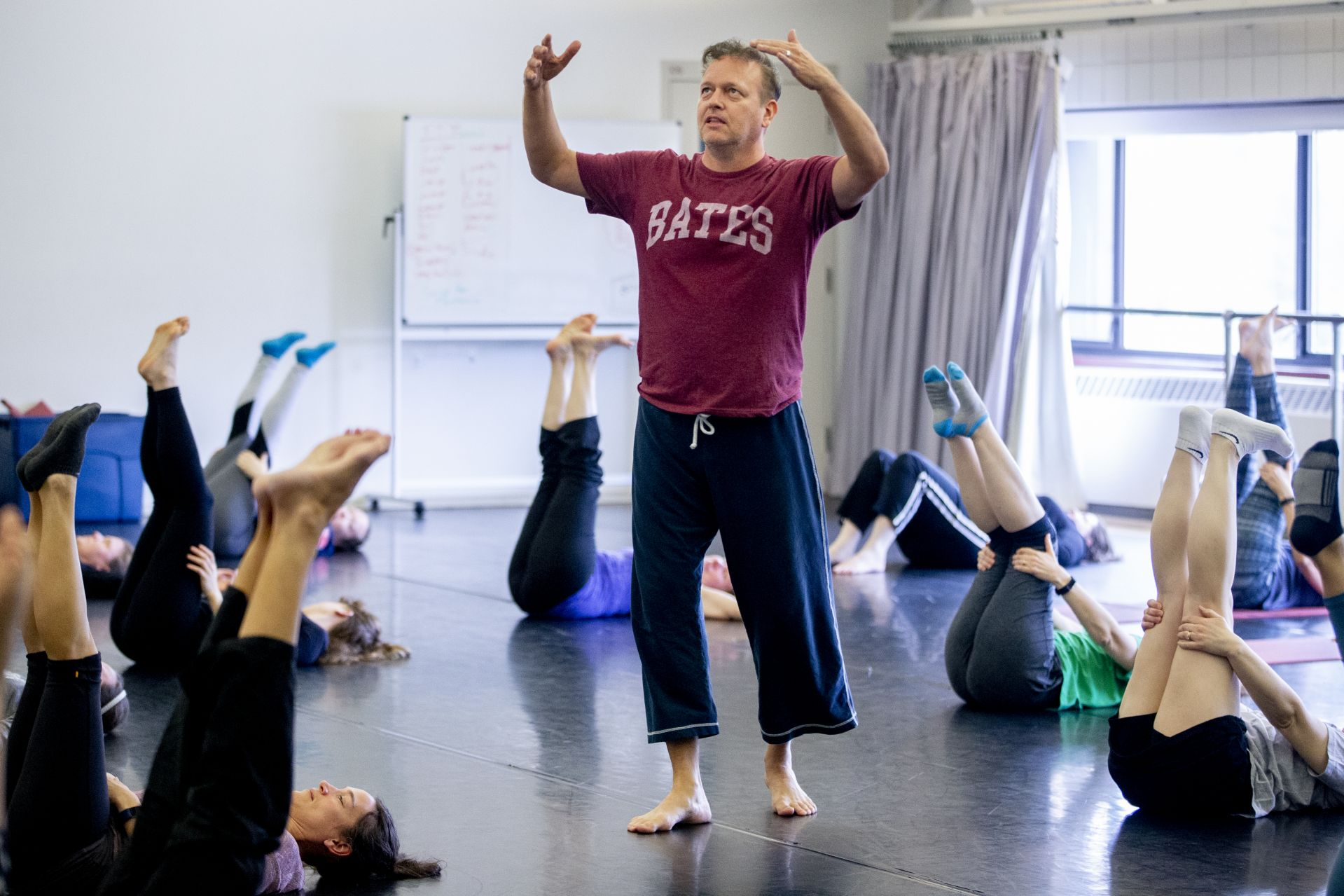 """""""It's incredibly edifying go be in the presence of such strong women who this program built its shoulders upon.""""Michael Foley '89 opens his class on Modern Dance for the over-40s in the Marcy Plavin Dance Studios. The session was one of several classes held on campus this morning as part of the weekend-long """"50 Years of Bates Dance"""" celebration ."""