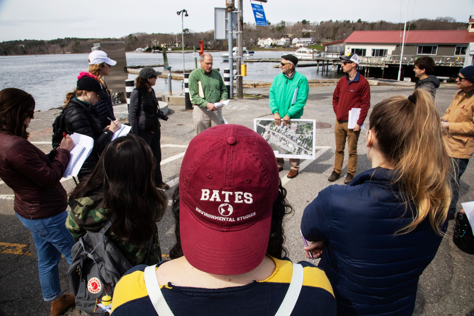 Bates students hear about flood response planning from Damariscotta Town Manager Matt Lutkus, center left, and former county planner Bob Faunce, center right, during their May 1 visit. (Theophil Syslo/Bates College)