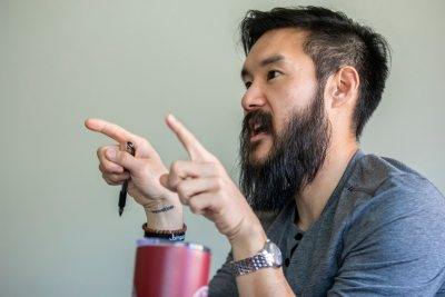 "Eugene Kim '08 teaches a practitioner taught marketing course, with guest speakers from Lululemon, a yoga clothing company.Featuring two students in the course, David Akinyemi '21 from Bealeton, Va., and Mamta Saraogi '21 from West Bengal, India.""Screw Your Brand:"" Marketing with Higher Purpose for the Conscious Human""Lead Practitioner: Eugene Kim, Bates '08Course Overview: Brands and products are a dime a dozen. In today's world of overabundance, overstimulation, and endless access to information, the brands and companies with staying power are doing more than just marketing. In this course, students learn what it means to be a purpose-driven marketer and how brands and companies build relationships with their audience through community-building and analog connection. We discuss how companies with higher purpose market differently than product-driven companies, and how that can activate at the local level. Students learn the fundamentals of building a brand and marketing campaign, but this course challenges them to think outside the box of traditional marketing strategies to leverage brand building and marketing to create and leave lasting change in the community around them."