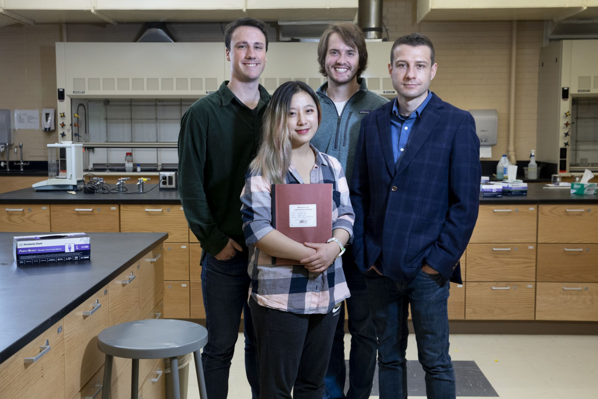 Four of the coauthors of the scholarly article describing the creation of Bobcat339 pose in Dana Chemistry lab: from left, Michael Bennett '19, Haoyu Sun '19, Nathanael Kuzio '19, and Andrew Kennedy. (Phyllis Graber Jensen/Bates College)