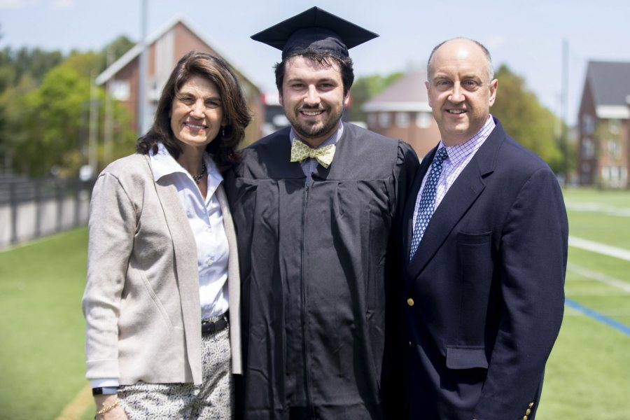 Posing on May 25, the day before Commencement, are Gordon Platt '19 and his parents, Julie Sutherland Platt '88 and Halsey Platt '88. (Phyllis Graber Jensen/Bates College)