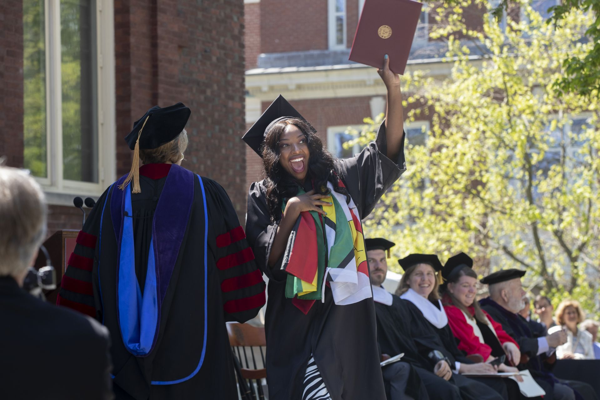 Kudzaiishe Irene Mapfunde, a psychology major, displays her diploma exuberantly. (Phyllis Graber Jensen/Bates College)