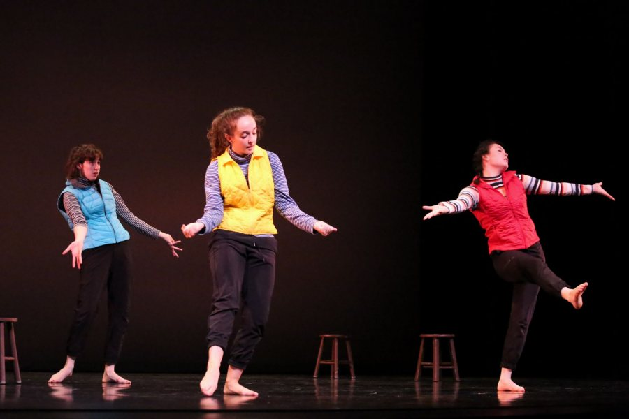 """current dance students Flannery Black-Ingersoll '19 (blue), Becca Howard '19 (red), and Shae Gwydir '20 (yellow) perform """"Contact Disco""""- a piece they choreographed in their Advanced Composition class."""