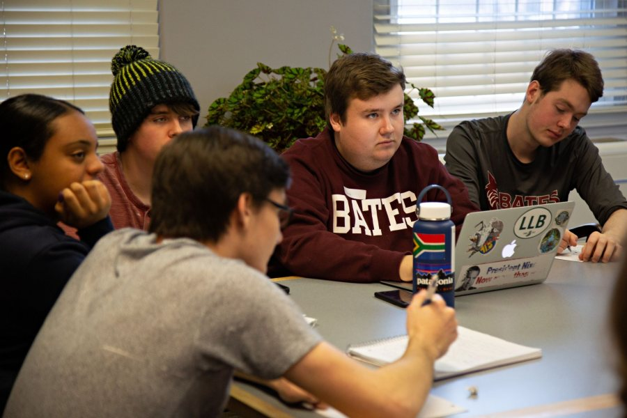 In January, Harry Meadows '19 (second from right) was part of a workshop that Bates debaters held for visiting high school students from Boston. (Grace Link '19/Bates College)
