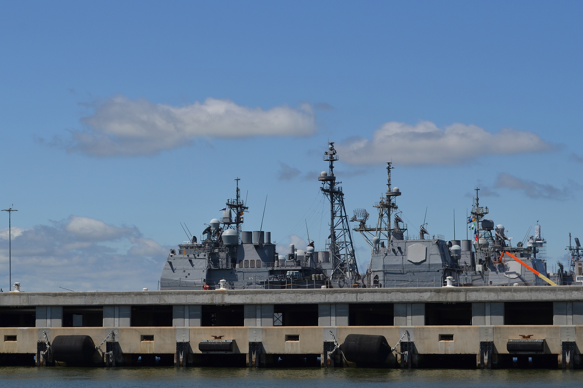 The Navy has added a second deck to some piers at Naval Base Norfolk to accommodate higher water levels and expedite the handling of cargo. (Lynne Lewis for Bates College)