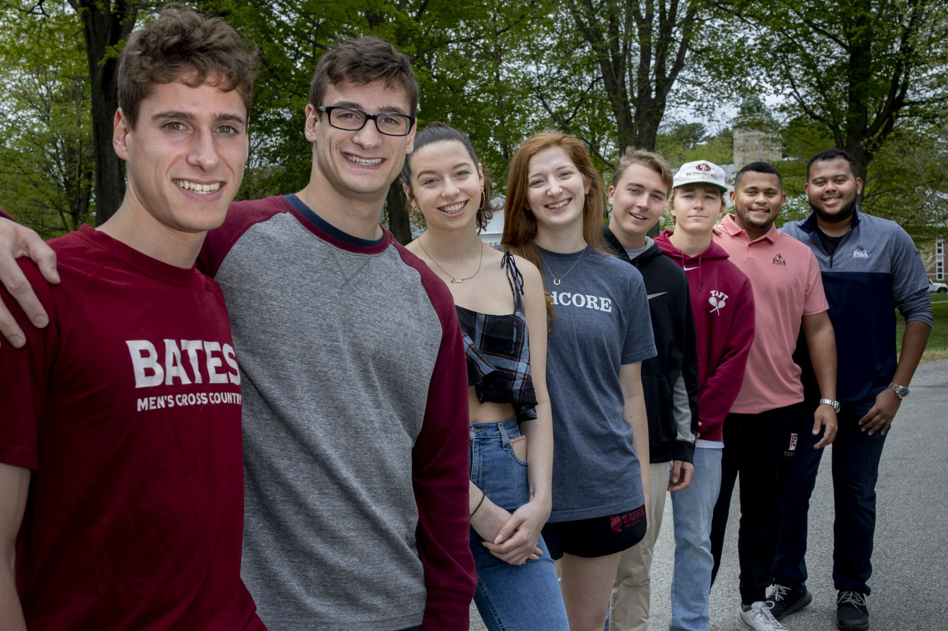 "Four sets of graduating twins, each from the Class of 2019, gather on the historic Quad for portraits.Duane Davis (pink shirt) and Dylan Davis (blue shirt) John Cannon (black pullover) and William ""Coley"" Cannon (garnet pullover and white hat) Daly Naughton (hoop earrings)and Claire Naughton (blue t-shirt) Mark Fusco (Bates shirt) and Frank Fusco (glasses)"