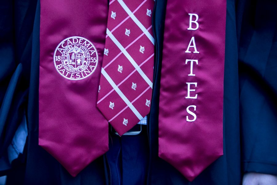 Bates College 2019 Commencement (the one hundred and fifty-third) on the Historic Quad, at which Travis Mills receives an Doctor of Humane Letter. Placing the collar on Mills is the college's mace bearer, Charles Franklin Phillips Professor of EconomicsMichael Murray.