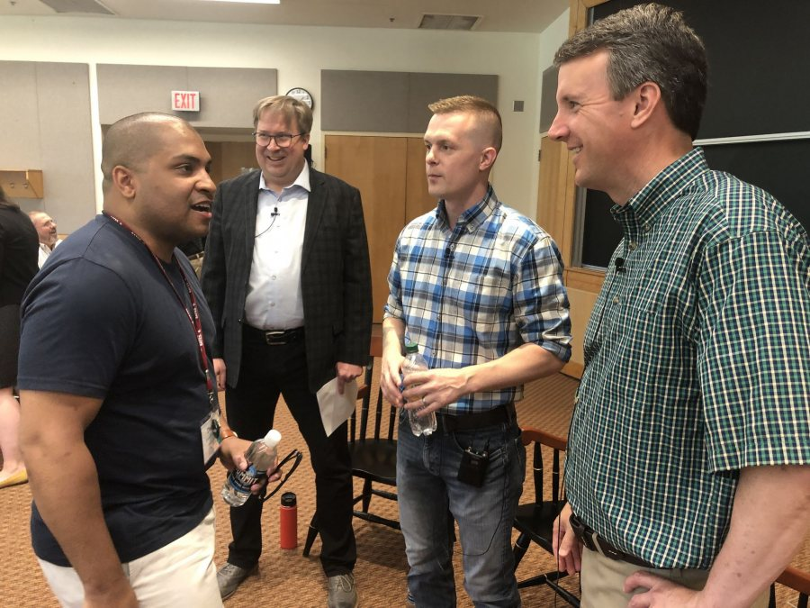 Darnell Morrow '14 greets Ben Cline '94 prior to the Reunion discussion on June 8. Both graduates of Washington and Lee Law School, the pair had met once before, when on opposite sides of a legal case. (Jay Burns/Bates College)