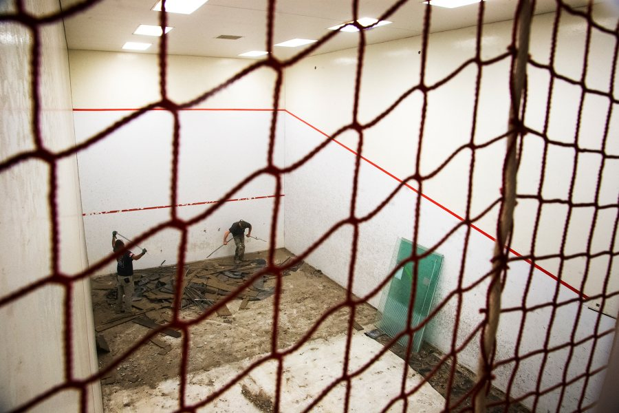 Demolition of an under-used Merrill Gym squash court in June 2019. The area is being repurposed into a physical therapy area for Bates' sports medicine program. (Theophil Syslo/Bates College)