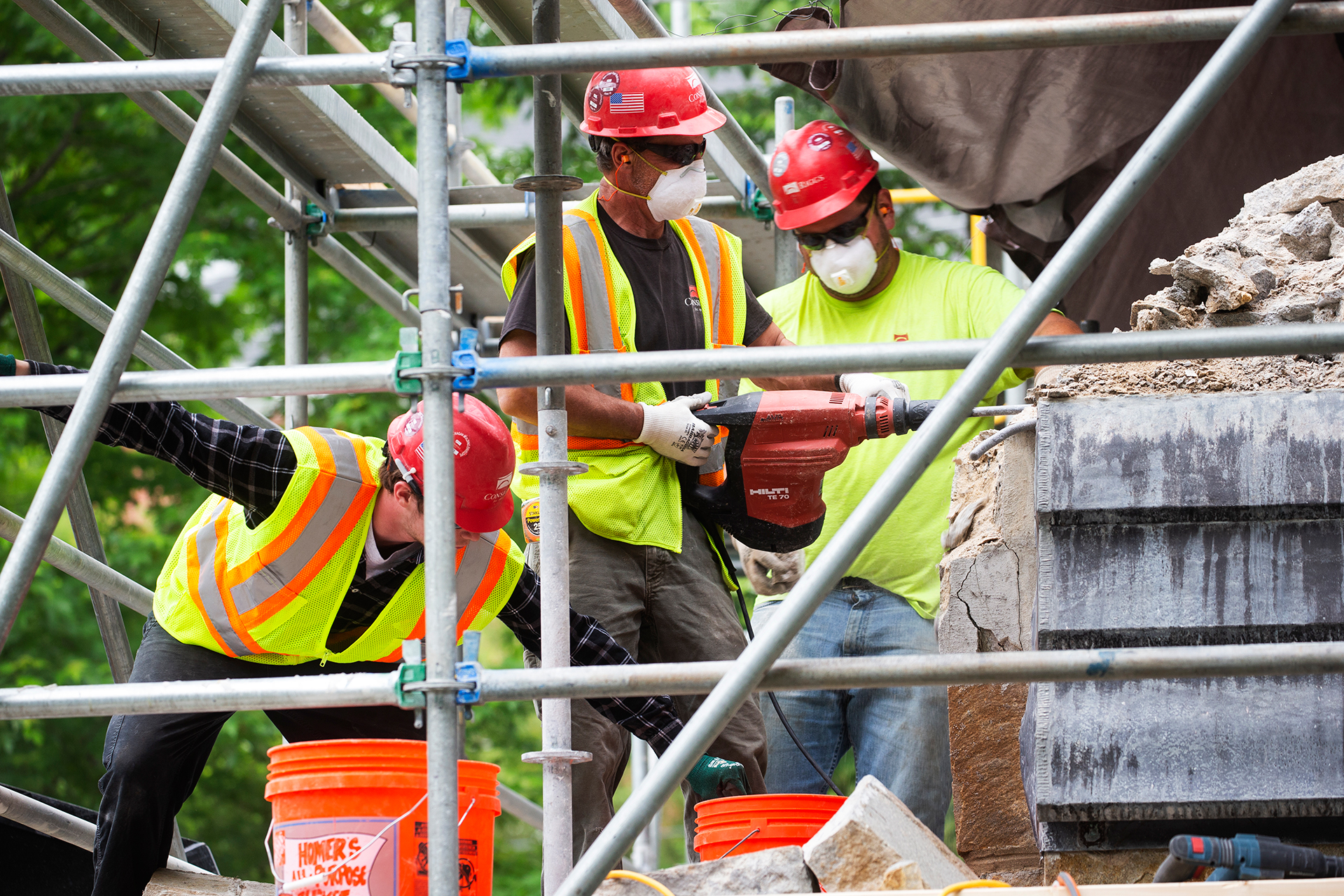 Consigli Construction masons at work on the Gomes Chapel exterior on June 17, 2019. (Theophil Syslo/Bates College)