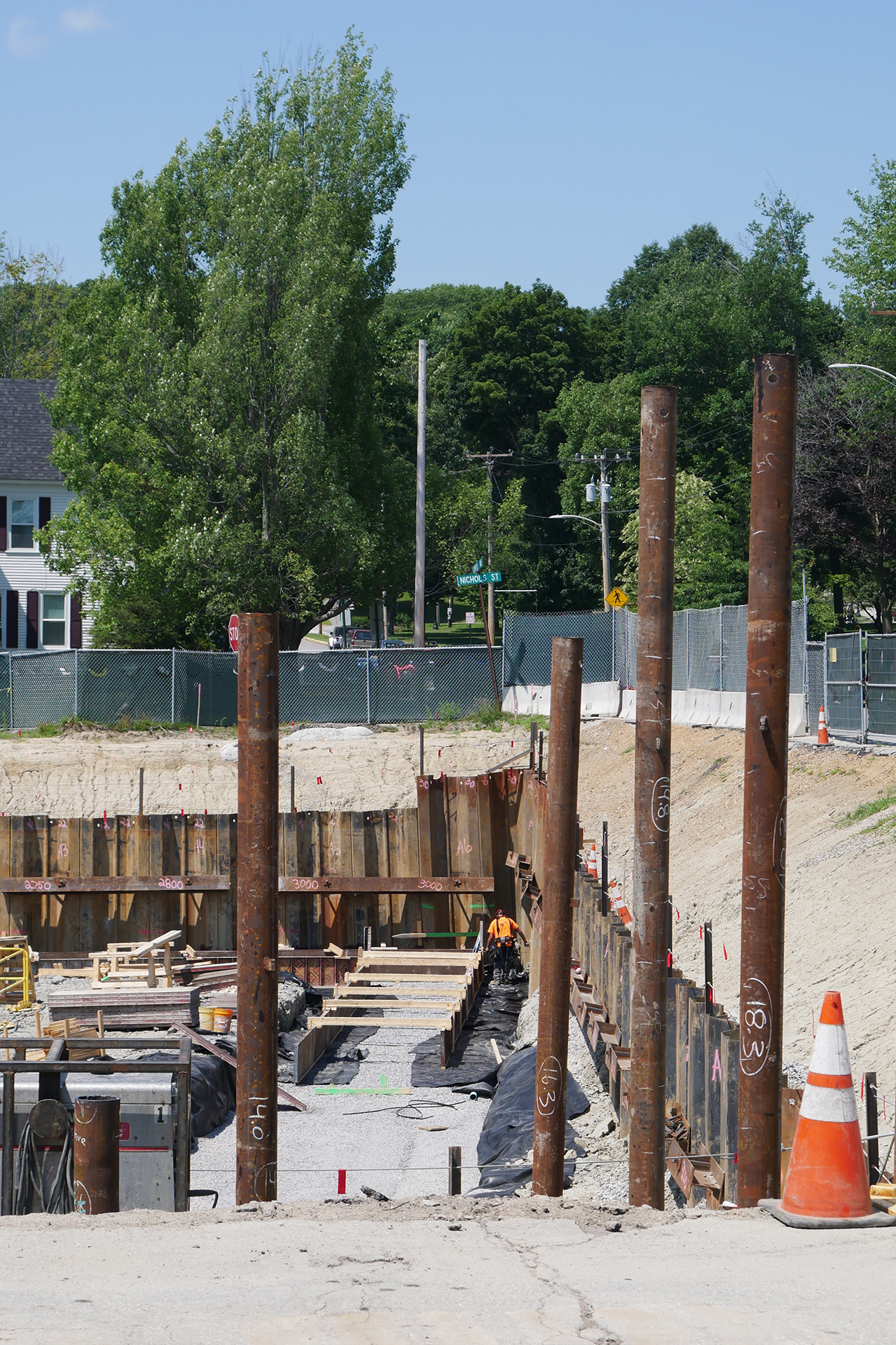 The way things stood at the Bonney Science Center site on July 30, 2019: In the foreground are freshly driven pipe piles at the easternmost end of the site. At the lower center are newly placed forms for concrete foundation footings. (Doug Hubley/Bates College)