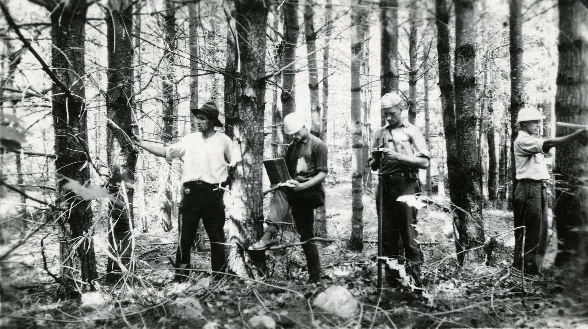 In 1921, AssistantProfessor of Forestry Bernard Leete, left, led aspiring Bates forestry majors during summer fieldwork in the Bates Forest. (Muskie Archies and Special Collections Library)