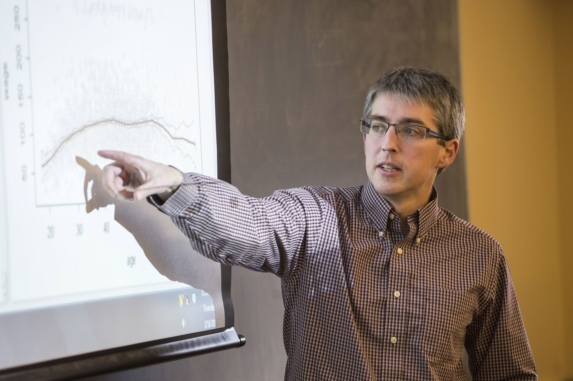 Assistant Professor of Economics Nathan Tefft analyzes equations and data sets in Big Data and Economics on Feb 18, 2016.