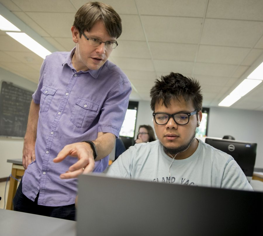 Seen in 2017, Assistant Professor of Physics Aleks Diamond-Stanic works with Jose Ruiz '19, who graduated in May with a physics degree. (Phyllis Graber Jensen/Bates College)