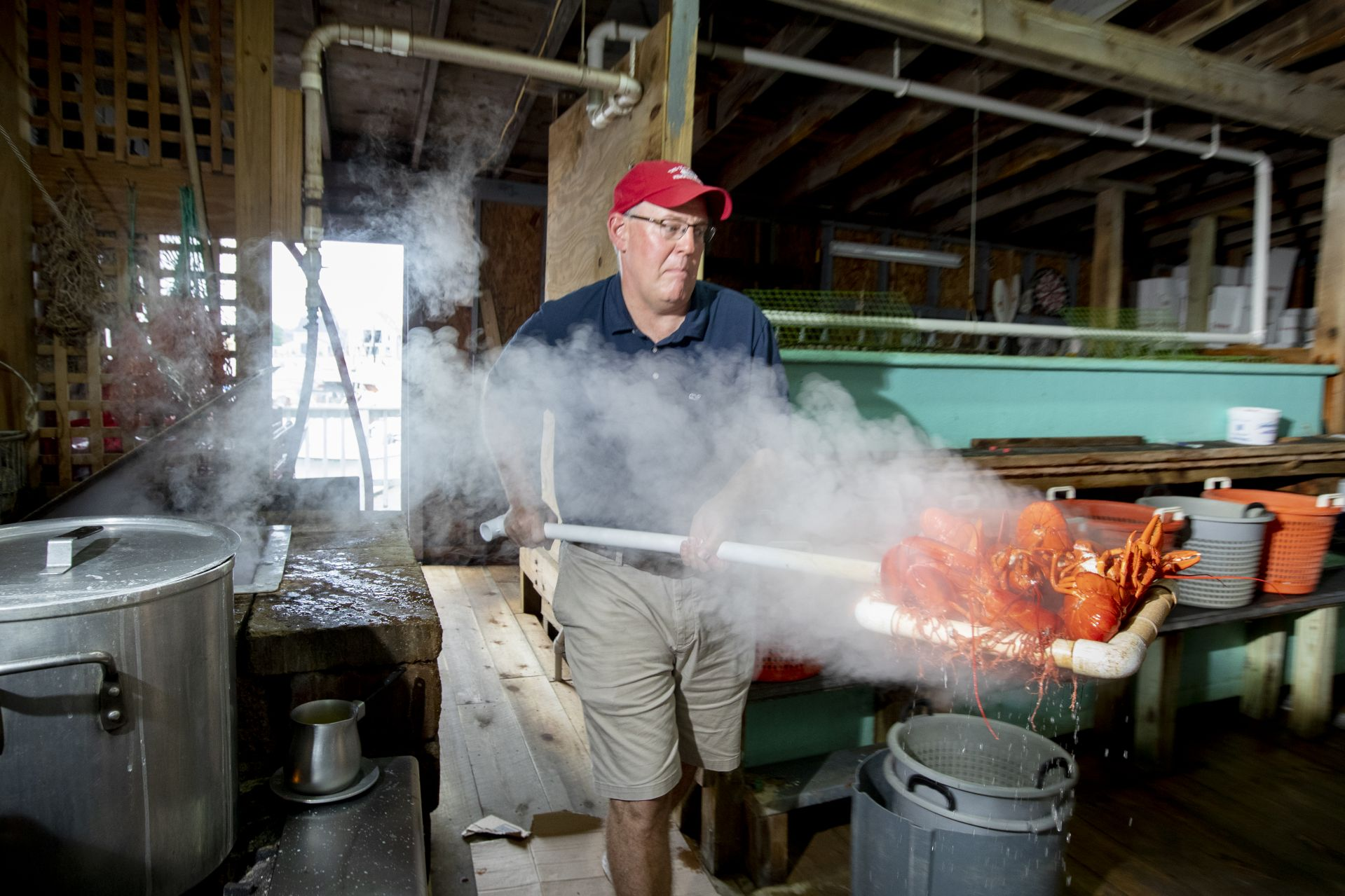 Next door to the Clam Shack, Steve Kingston scoops freshly cooked lobsters from a kettle that dates to the 1930s. (Phyllis Graber Jensen/Bates College)