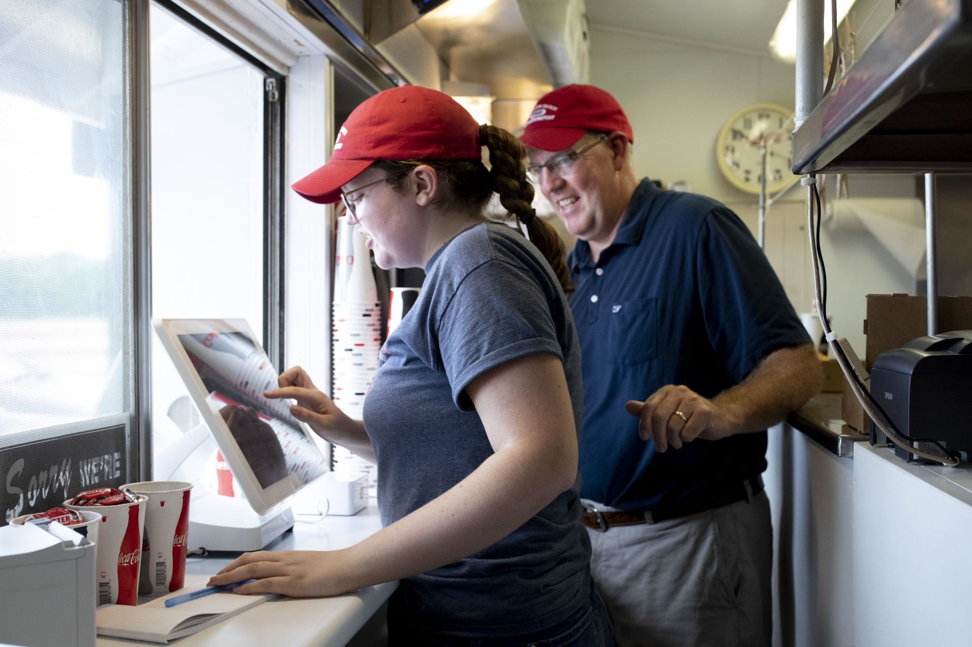 Steve Kingston '88 is owner of an iconic tourist spot, The Clam Shack (at 2 Western Ave. in Kennebunk), famed for its lobster rolls.With daughter Piper, 19, at the cash register